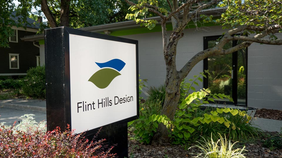 Flint Hills Design exterior sign in front of the office building.